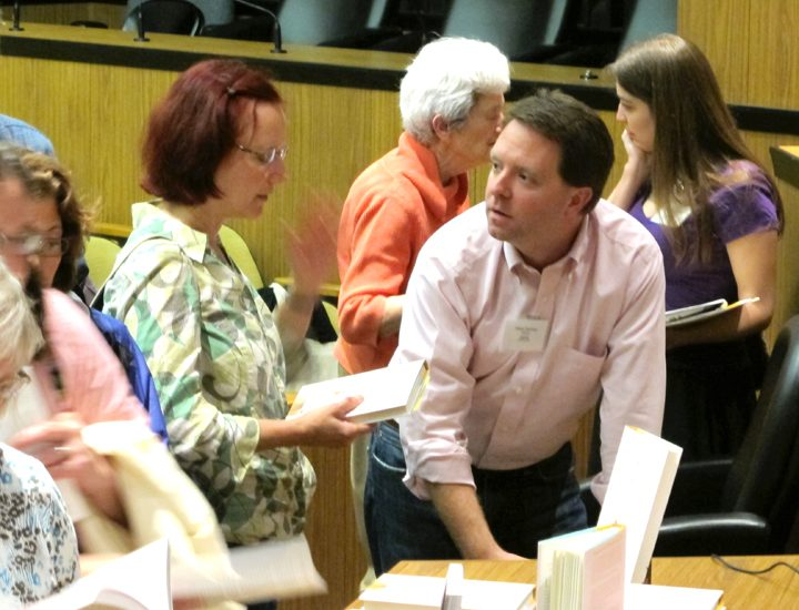 <p>Matt Paxton signs copies of The Secret Life of Hoarders: True Stories of Tackling Extreme Clutter at the Virginia Festival of the Book. - Photo by Jeanne Siler>