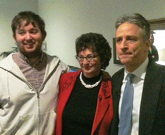 Elizabeth Dowling Taylor with her son Luke and The Daily Show host Jon Stewart at the taping.