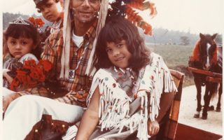 <p>A father and his three children pose for photographer William Bradshaw at the Chickahominy Reservation in Charles City County in 1969. Courtesy of Valentine Richmond History Center.</p>