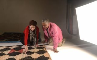 Kathleen Curtis Wilson (left) and Perlista Henry preparing Lizzie's quilts for documentation. Photo by Pat Jarrett