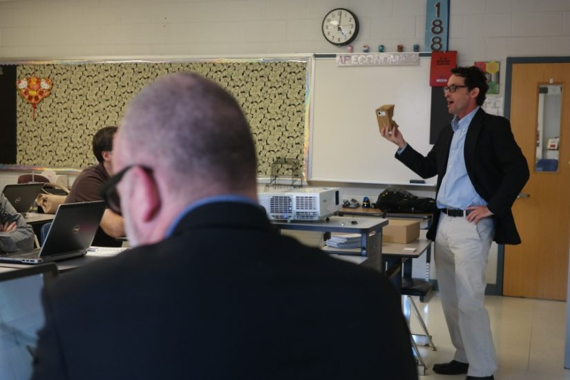 Demonstrating Google Cardboard VR device to middle school teachers at McLean High School