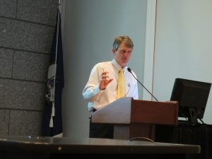 "Greg Wilson delivering a talk ""Toxic Dust"" at the Library of Virginia in 2016. Photo by Jeanne Siler."