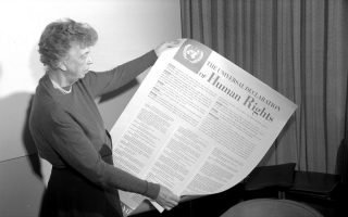 Eleanor Roosevelt holding the UDHR