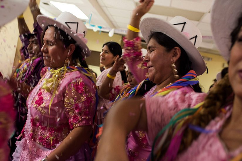 Women sang and danced with their comparsa during Los Picaflores carnival party in Arlington, Virginia on February 20, 2016. Photo by Carey Averbook.