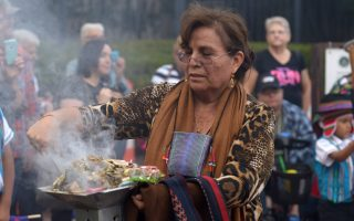 Julia Garcia makes on offering of burning herbs and colorful paper during a traditional Bolivian Mesa Ceremony at the Richmond Folk Festival on 10/10/15. Photo by Pat Jarrett
