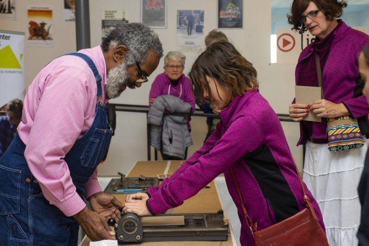 Amos Paul Kennedy Jr. demonstrated printing techniques during a screening of a documentary Proceed and Be Bold! at Light House Studio's Vinegar Hill Theater in Charlottesville on 11/17/18.