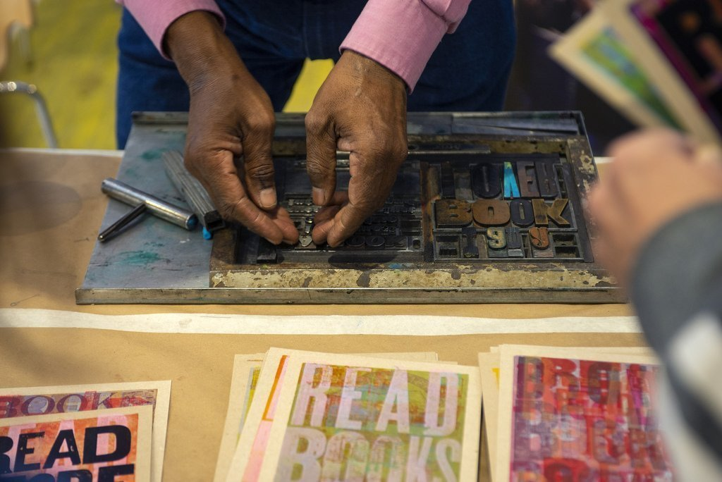 Amos Paul Kennedy Jr. demonstrated printing techniques during a screening of a documentary Proceed and Be Bold! at Light House Studio's Vinegar Hill Theater in Charlottesville on 11/17/18. Photo by Pat Jarrett/Virginia Humanities